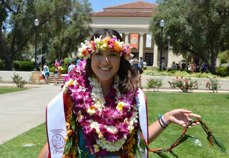 Women wearing Hawaiian leis at graduation