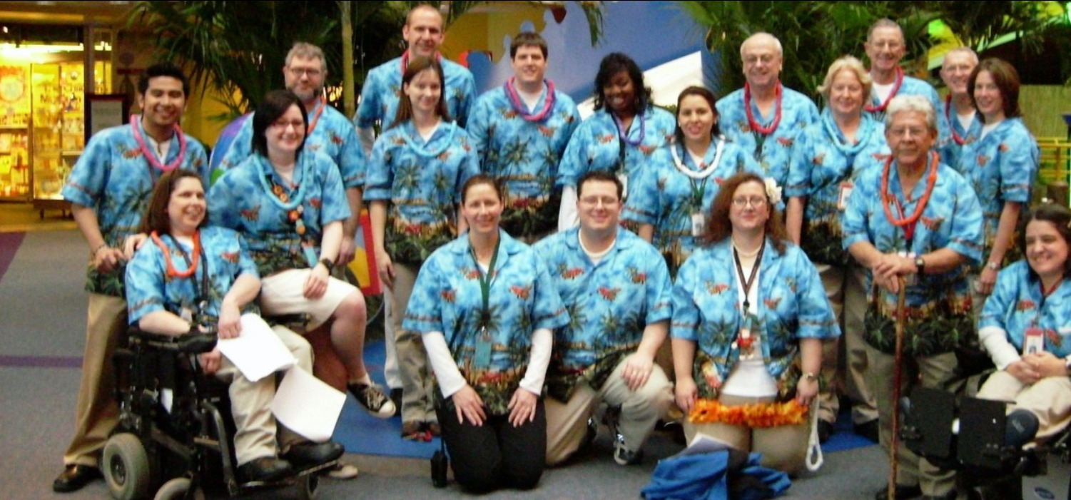 Group photograph of the staff at the Children's Museum of Indianapolis wearing Hawaiian shirts purchased in bulk from our Group Sales department.